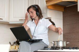bigstock-Multitasking--preparing-meal--33068042